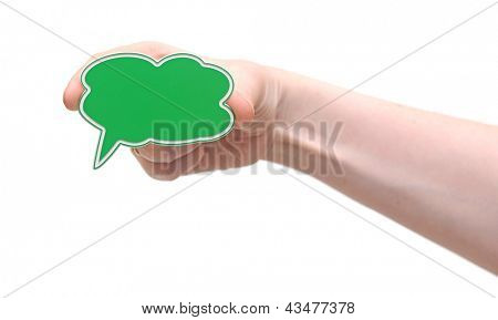 Hand holding green speech bubble symbol
