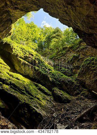 Entrance Of Scarisoara Cave, Apuseni Mountains, Romania
