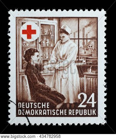 ZAGREB, CROATIA - JUNE 25, 2014: A stamp issued in Germany - Democratic Republic (DDR) on occasion of the 1st Anniversary of founding the Red Cross, circa 1953.