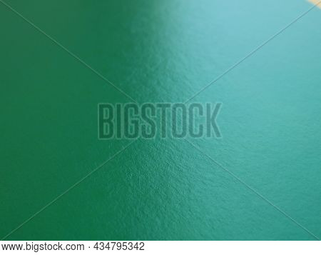 Dark Green Matte Texture Paper Background In Uneven Lighting, Colored Cardboard As A Blank Canvas, D