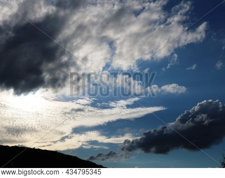 Beautiful Cloudy Sky With Sunlight Behind The Clouds, Morning Or Evening Aerial Landscape With A Pla