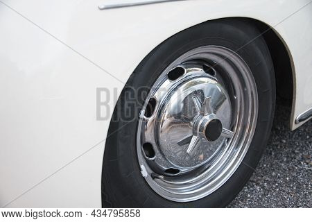 Closeup Partial View Of White Vintage Car With Alloy Rim And Tyre