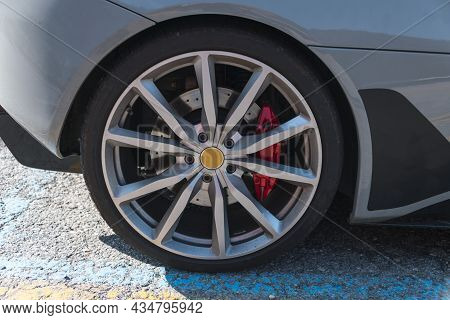 Closeup Partial View Of Modern Sports Car With Alloy Rim And Tyre