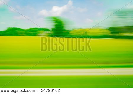 Travel And Rural Background Long Exposure Motion Blur From Train Passing Through Netherlands Rural L
