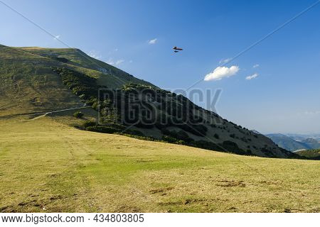 Hang Glider Just After Launch From Monte Cucco Regional Park, Umbria, Italy
