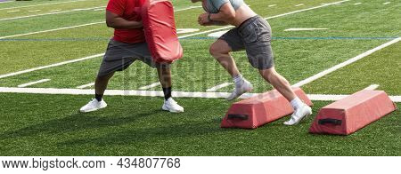 High Schooll Football Player Avoiding Red Barriers And Hitting The Coaches Pad At The End During Sum