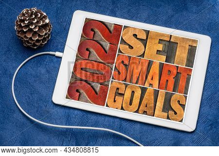 2022 set smart goals  concept - isolated word abstract in vintage letterpress wood type on a digital tablet, goal setting for New Year
