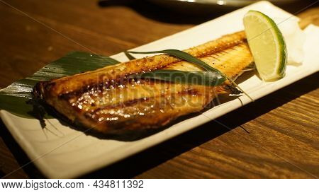 Tasty And Delicious Fried And Grilled Fish In White Plate On Wooden Table Fresh And Healthy Eating M