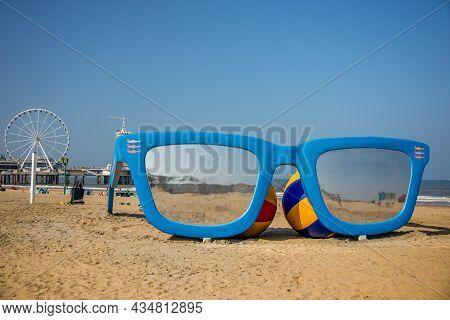 03 September 2021, Scheveningen Beach, The Hague, Netherlands, Model Of  Cun Glasses On The Sand Wit