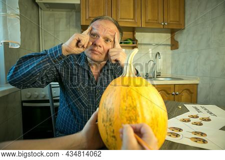 The Process Of Creating A Jack O'lantern Theme Template. A Man And A Woman Are Preparing A Pumpkin F