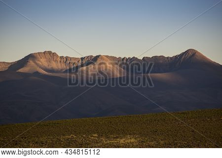 Crown Shaped Dry Mountains At Late Afternoon With Last Sunrays In Puna Argentina, Near Yavi Town. No