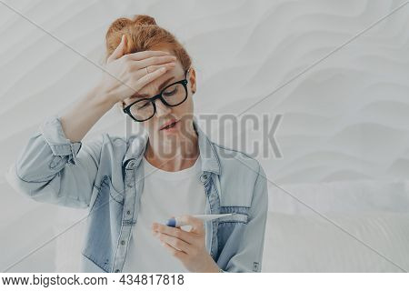 Desperate Unhappy Young Woman Sad Because Of Infertility Keeps Hand On Forehead Looks At Pregnancy T