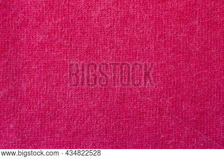 Background Texture Of Red Pattern Knitted Fabric Made Of Angora Or Wool. Close Up.