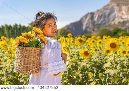 Girls Travel In Fields Of Blooming Yellow Sunflowers In The Summer Season In Sunflowers Farm And Oth