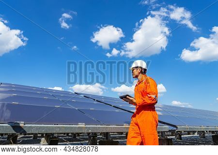 The Solar Farm(solar Panel) With Engineers Walk To Check The Operation Of The System, Alternative En