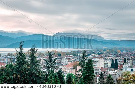 The Skyline Of Ioannina City In Epirus, Greece, With The Lake Pamvotis And Mitsikeli Mount In The Ba