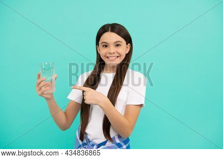 Happy Kid Drink Glass Of Water To Stay Hydrated And Keep Daily Water Balance, Pointing Finger.