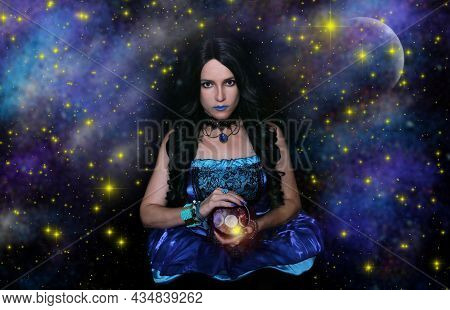 Female Psychic With Crystal Ball And Galaxy Background