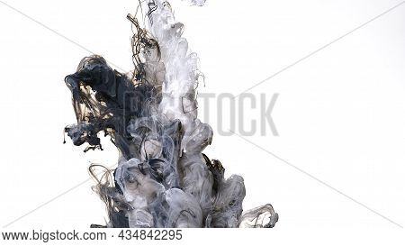 Colored Acrylic Paints Are Mixed In Water. Awesome Abstract Background. Black And White Cloud Of Ink