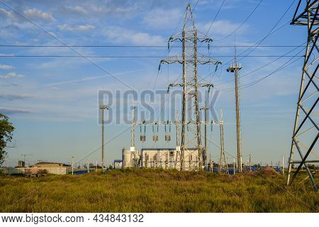 Small Electrical Substation In The Field Against The Blue Sky. Horizontal Photo.