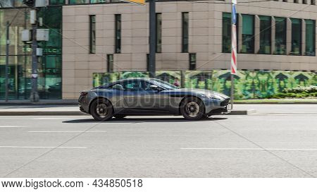 Aston Martin Db11 Car Moving On The Street On High Speed. Luxury Two Door Coupe Produced By Aston Ma