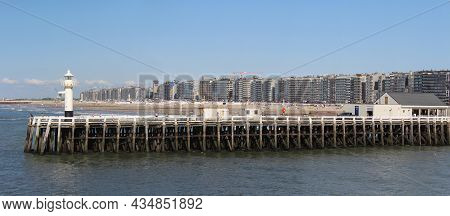 Blankenberge, Belgium, 2 August 2021: View Of The Jetty At Blankenberge Harbour In West Flanders, Wi