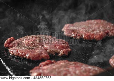 Process Of Cooking Cheeseburgers On The Grill.  Close Up Beef Meat Burgers For Hamburger