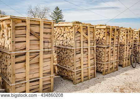 Stacks Of Firewood For Industrial. Piles Of Firewood. Natural Wooden Background - Closeup Of Chopped