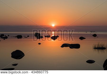 Beautiful Golden Sunset On The Lake. The Colorful Sky And The Colorful Water In The Lake Are Reflect
