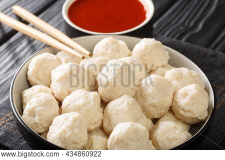 Authentic Indonesian Boiled Chicken Meatballs Bakso Served With Hot Sauce Close-up In A Bowl On The