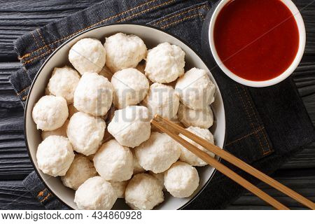 Chicken Meat Balls Bakso Ayam With Sauce Close Up In The Bowl On The Table. Horizontal Top View From