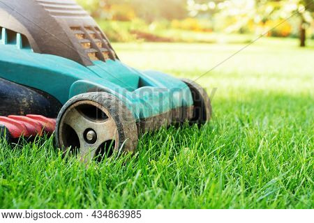 Lawn Mower On Grass Closeup View. Lawn Care Concept