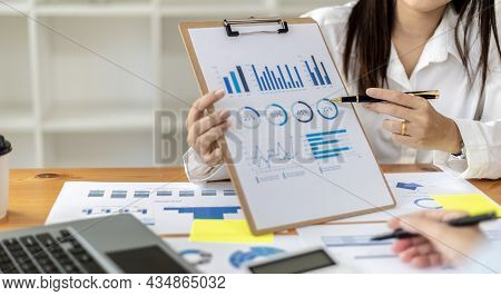 Atmosphere In The Meeting Room Of A Startup, The Chief Financial Officer Is Presenting The Company's