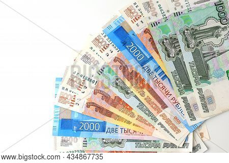 Russian Rubles Are Fanned Out On A White Background. Currency Exchange. Financial Crisis, Ruble Deva