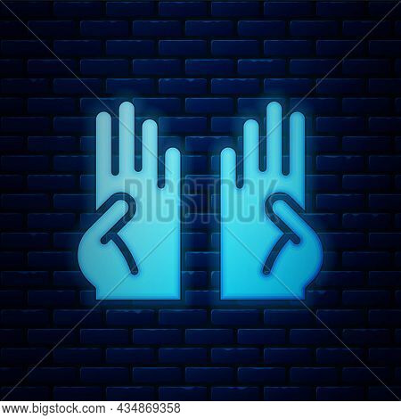 Glowing Neon Rubber Gloves Icon Isolated On Brick Wall Background. Latex Hand Protection Sign. House