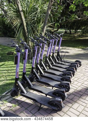 Sochi, Russia - May 27, 2021. Kick Scooters For Rent In Urban Park. Eco-friendly And Comfortable Urb