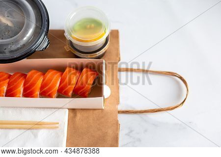 Sushi delivery. Delivery of delicious, beautiful sushi in a package. Food delivery home in craft pac