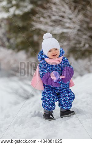 Cute Two Year Old Kid Playing With Snowballs Maker Toy. Smiling Little Girl Having Fun In Winter Par