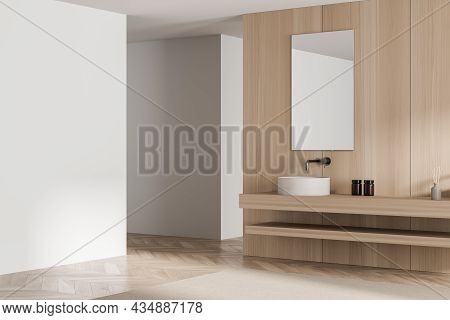 Corner View Of Wooden Bathroom Interior With Modern Floating Vanity, Mirror, Beige Rug And Empty Whi