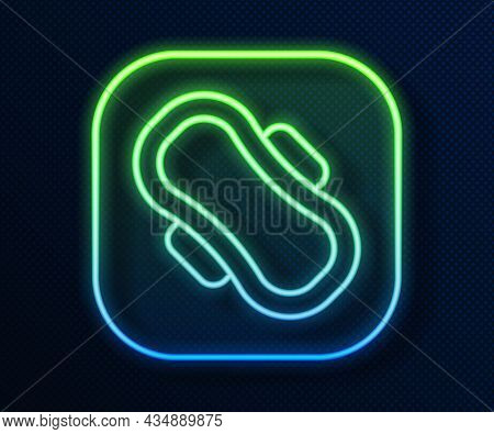 Glowing Neon Line Menstruation And Sanitary Napkin Icon Isolated On Blue Background. Feminine Hygien