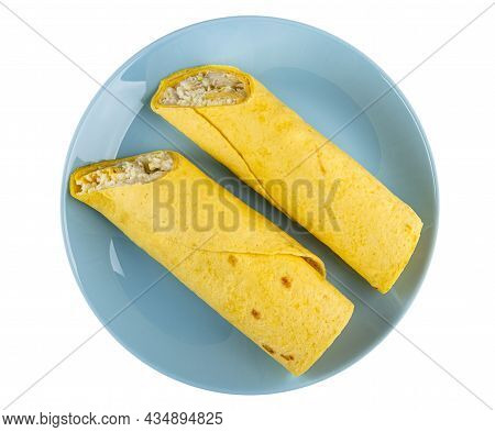Two Tortilla Wraps With Caesar Salad In Blue Glass Plate Isolated On White Background. Top View