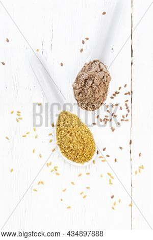 Bran And Flour Flaxseed In Spoons On White Board Top