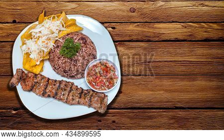Roast Beef With Gallo Pinto And Pico De Gallo, Nicaraguan Food Served On Wooden Table, Plate With Ro