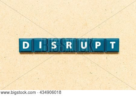 Tile Alphabet Letter In Word Disrupt On Wood Background