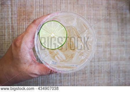 Lime Juice Or Lemon Juice, Lemon Soda Or Tonic Or Soda And Lime Sliced Topping