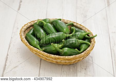fresh jalapeno peppers in basket