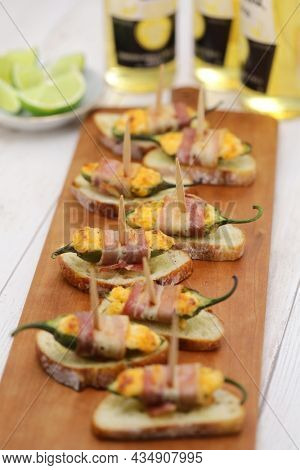 bacon wrapped jalapeno poppers, party appetizer