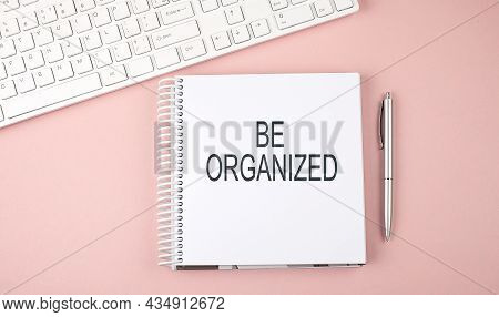 Pink Office Desk With Keyboard And Notebook With Text Be Organized,business