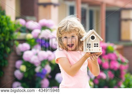 Excited Child Making A New Dream Home. Housing A Young Family. Amazed Boy Dream New Home.