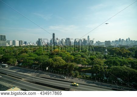 Public Park And High-rise Buildings Cityscape In Metropolis City Center . Green Environment City And